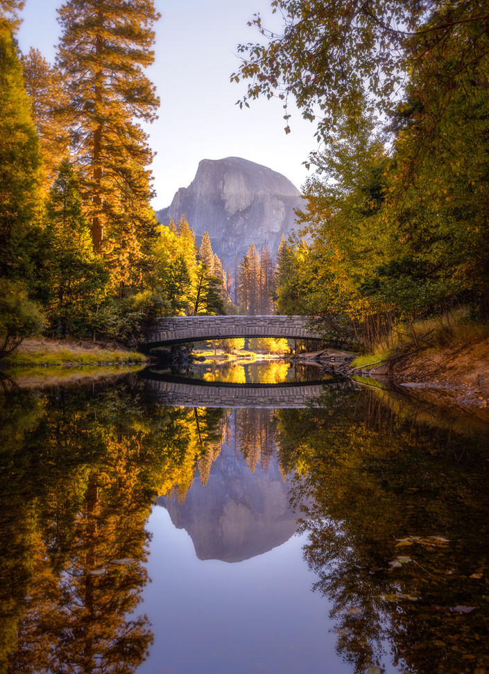 Photograph of Half Dome from Yosemite Valley with perfect reflection in the river